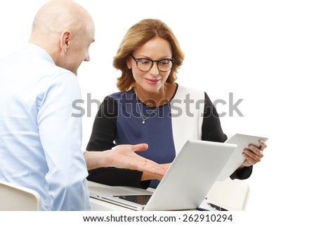 Business woman and businessman sitting at office with computer and digital tablet while using online banking. Isolated on white background.  - stock photo