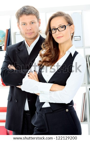 Business woman and businessman working together at the office. - stock photo