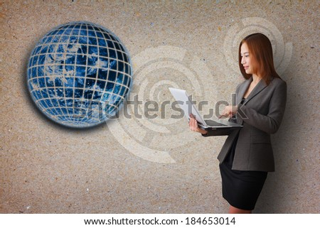 Business woman and earth background on paper : Elements of this image furnished by NASA - stock photo
