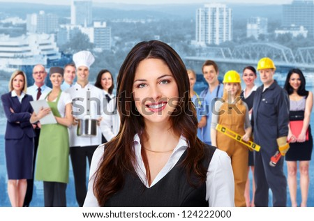 Business woman and group of industrial workers people. Over urban background. - stock photo