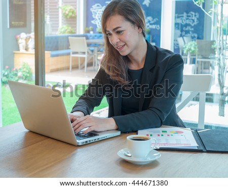 Business woman and partner working at the office. analysis document and using laptop   - stock photo