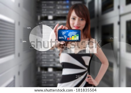Business woman and smart phone in data center room - stock photo