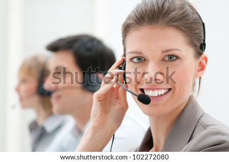 Business woman and team working at call center - stock photo