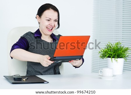 Business woman angry with computer - stock photo