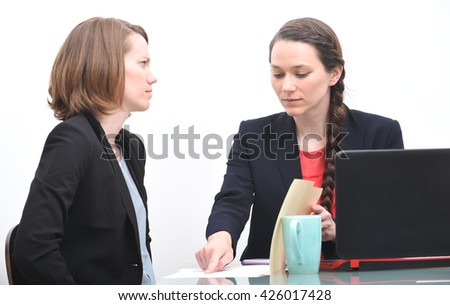 Business woman angry with her boss - stock photo