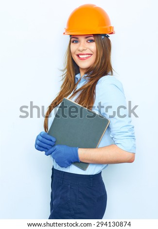 Business woman architect holding book. Studio isolated portrait of smiling woman . - stock photo