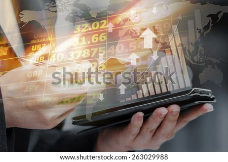 Business woman are checking exchange rates by using mobile phone - stock photo