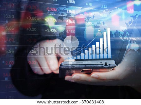 Business woman are checking stock market graph by using mobile phone