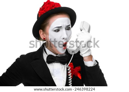 business woman as mime holding a handset and screaming into the phone, isolated on white background. Concept of surprise - stock photo