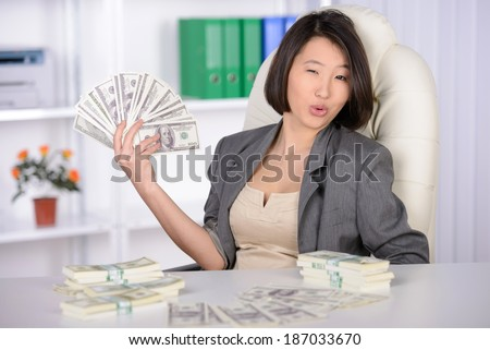 Business woman Asia, working in the office. Joy much money - stock photo