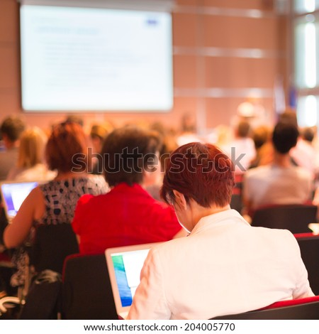 Business woman at Conference and Presentation. Audience at the conference hall. - stock photo