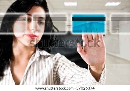 Business woman at office choosing credit card for online payment