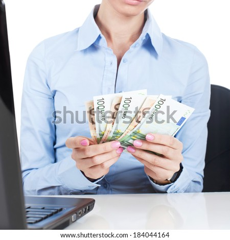 Business woman at office with euros in hands  - stock photo