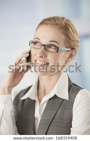 business woman at phone in workplace
