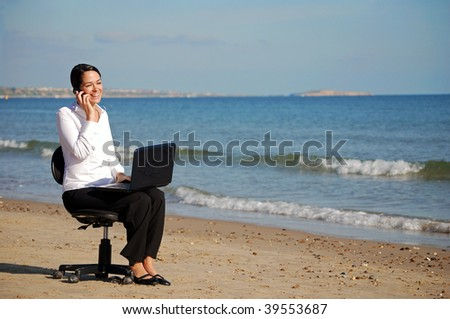 Business woman at the beach