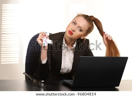 Business Woman at the Desk with laptop in an office - stock photo