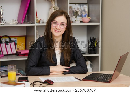 Business woman at the office in funny glasses