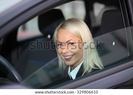 business woman at the wheel in the car. Young attractive girl behind the wheel