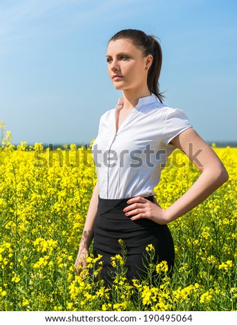 business woman at the yellow flower field - stock photo
