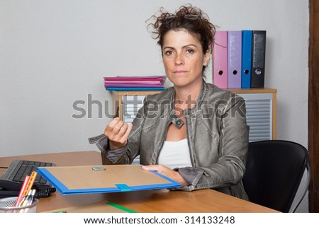 Business woman at work looking at the camera