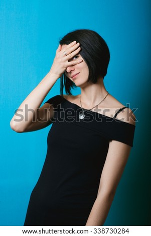 Business woman at work. Studio photo. The girl spies - stock photo