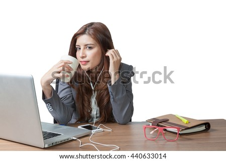 Business woman attractive beautiful sitting at office desk and enjoy with listening music and drinking coffee relaxation smile, have clipping path. - stock photo