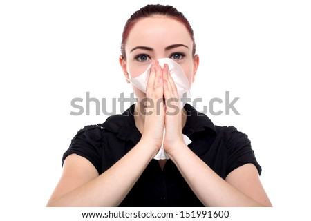 Business woman blowing nose