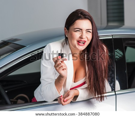 Business woman bought an expensive car.