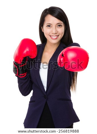 Business woman boxing punching towards camera - stock photo