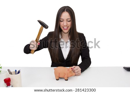 Business woman breaking piggy bank - stock photo