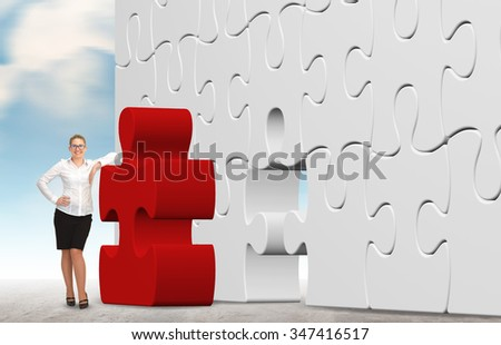 business woman building a red puzzle on a sky background