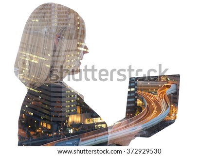 Business woman businesswoman with laptop computer internet city double exposure - stock photo