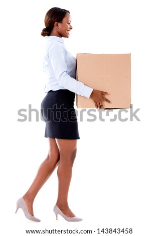 Business woman carrying a cardboard box - isolated over white - stock photo