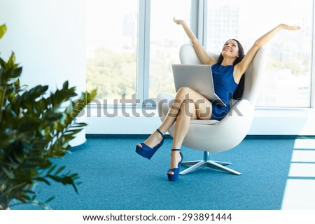 Business woman celebrates successful deal at office. Bussiness People - stock photo