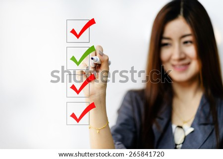 business woman checking on checklist boxes - stock photo