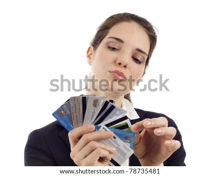 Business woman choosing which credit card to pay with, isolated over white