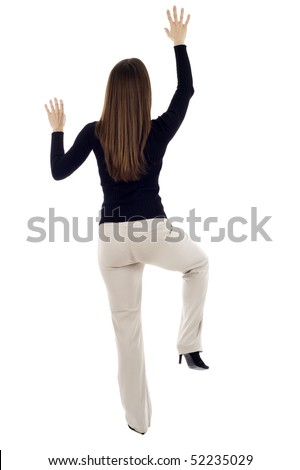 Business woman climbing a wall - determination, isolated over a white background