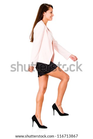 Business woman climbing stairs - isolated over a white background