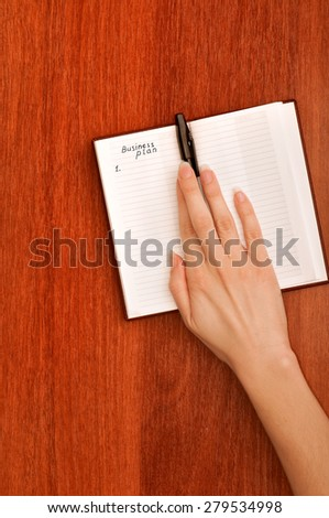 business woman create notes for business plan - stock photo