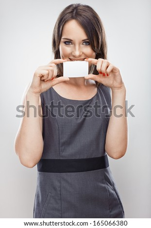Business woman credit card hold. Gray dress business model posing. Isolated. - stock photo
