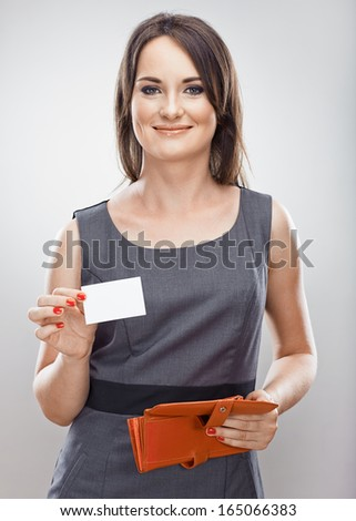 Business woman credit card hold. Gray dress business model posing. Isolated.