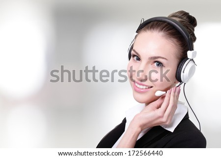 Business Woman customer service worker, call center smiling operator with phone headset.  - stock photo