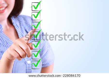 business woman designed on a checklist box - stock photo