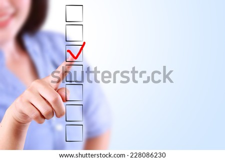 business woman designed on a checklist box