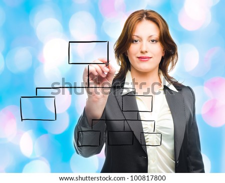 Business woman designing a plan on screen  with blue lights in the background - stock photo