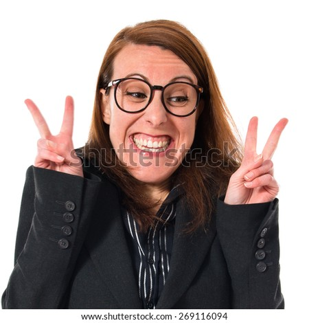 Business woman doing victory gesture  - stock photo