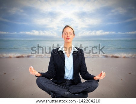Business woman doing yoga on the beach. Vacation. - stock photo