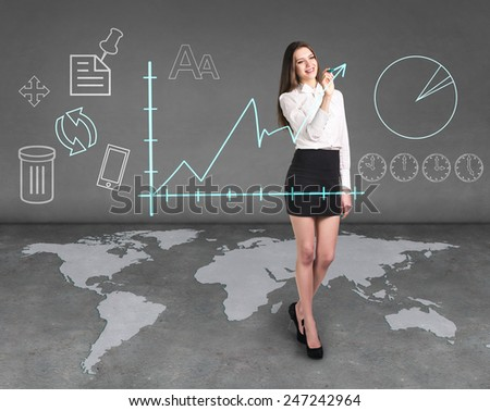 Business woman draw a graph, a global business - stock photo
