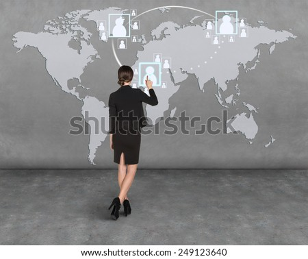 Business woman draw a map on the wall, a global business - stock photo