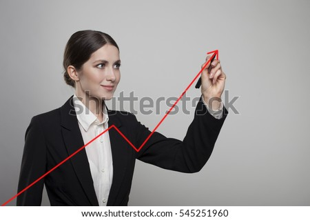business woman drawing a graph red arrow on a glass window